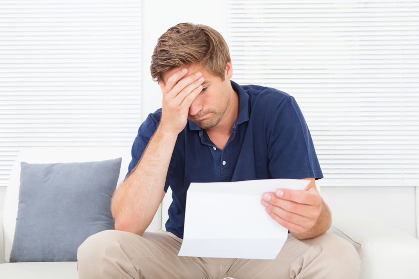 Man reading letter from IRS