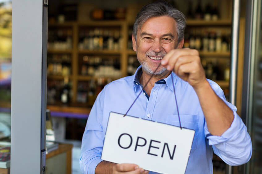 Burbank small business owner with open sign