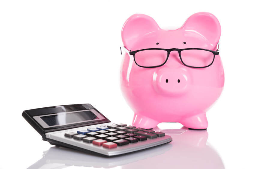 Piggy Bank wearing glasses next to calculator